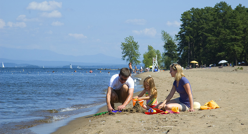 Ausable-Point-family-sitting-on-beach